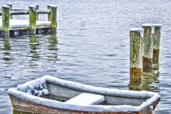 Row boat in snow Northport Harbor