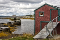 red fishing shack and fish house